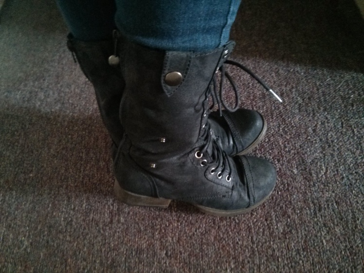 Wearing my own combat boots with skinny jeans. It also doubles as ankle boots when I unzip the back slightly and let the flaps on the side hang!