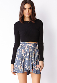 Pairing a solid top with a floral print skirt makes the skirt more eye catching.