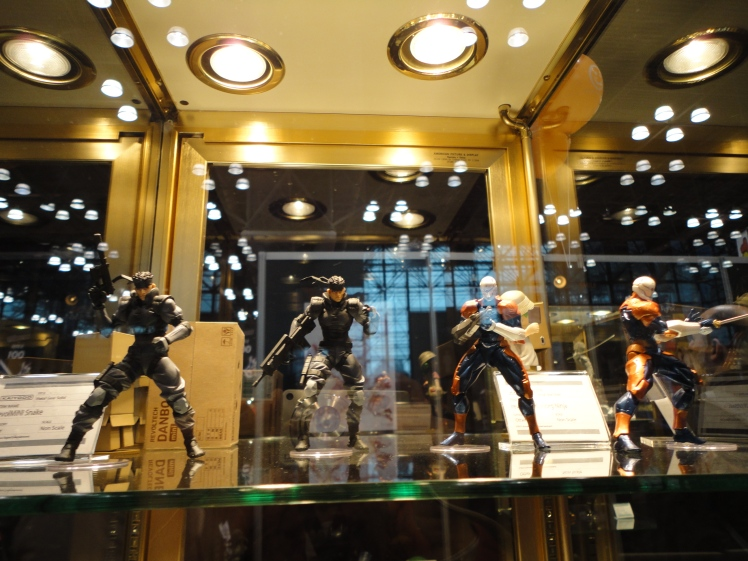 Some Metal Gear Solid figurines and one other figurine from a series I'm not familiar with.