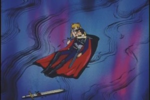 Sailor Moon cradles a lifeless Mamoru in her arms.