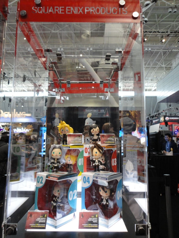 Square Enix merch on display.