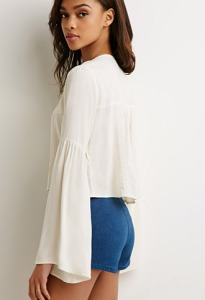 An airy bell sleeves top can keep you cool and looking pretty in the summer too.