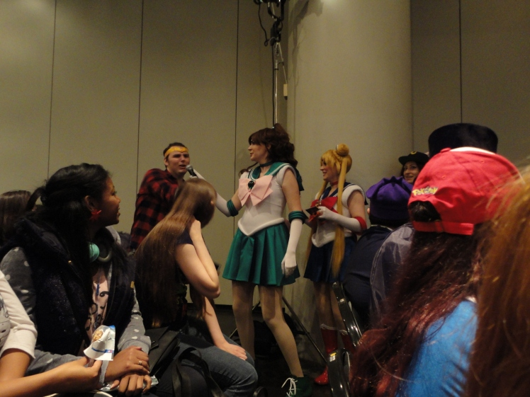 A guy who gave the right answer to a trivia question asked during the panel. Sailor Jupiter and Sailor Moon helped assist in the trivia question portion of the panel.