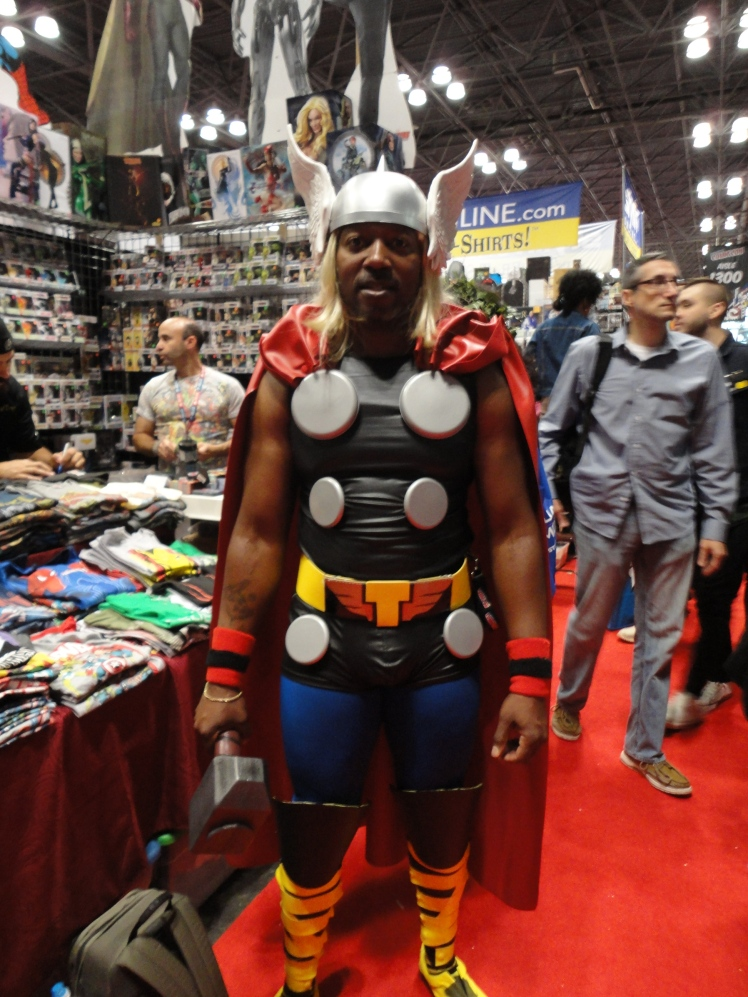 Thor taking a time out from checking out the merchandise for a photo.