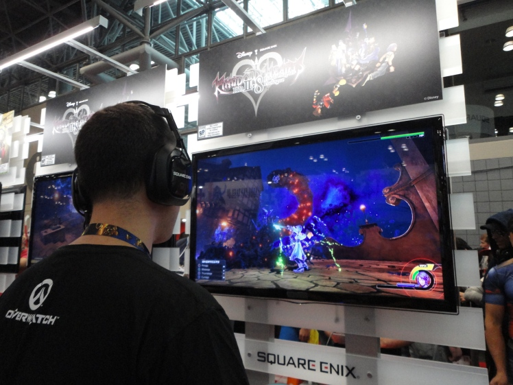 A gamer trying out a Kingdom Hearts game at the Square Enix booth.