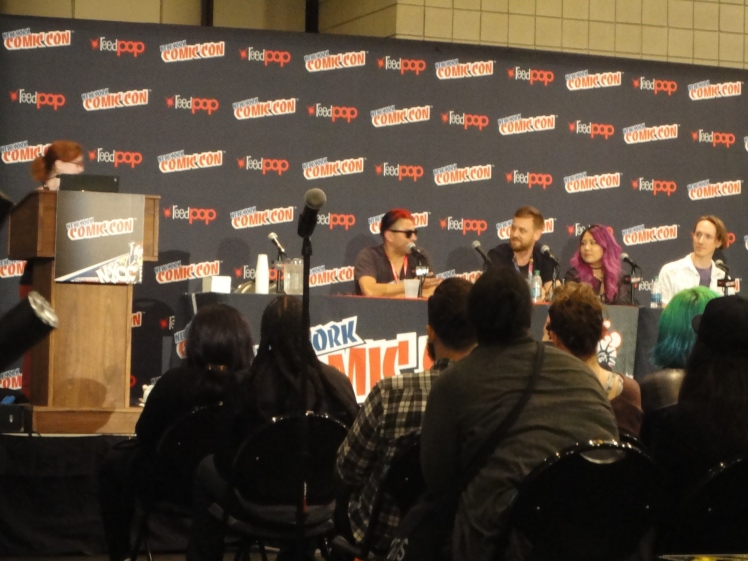 The speakers and artists for the Fashion, Comics panel.