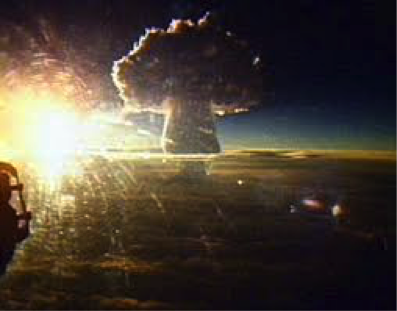 The mushroom cloud is 35 miles high at 100 miles away.
