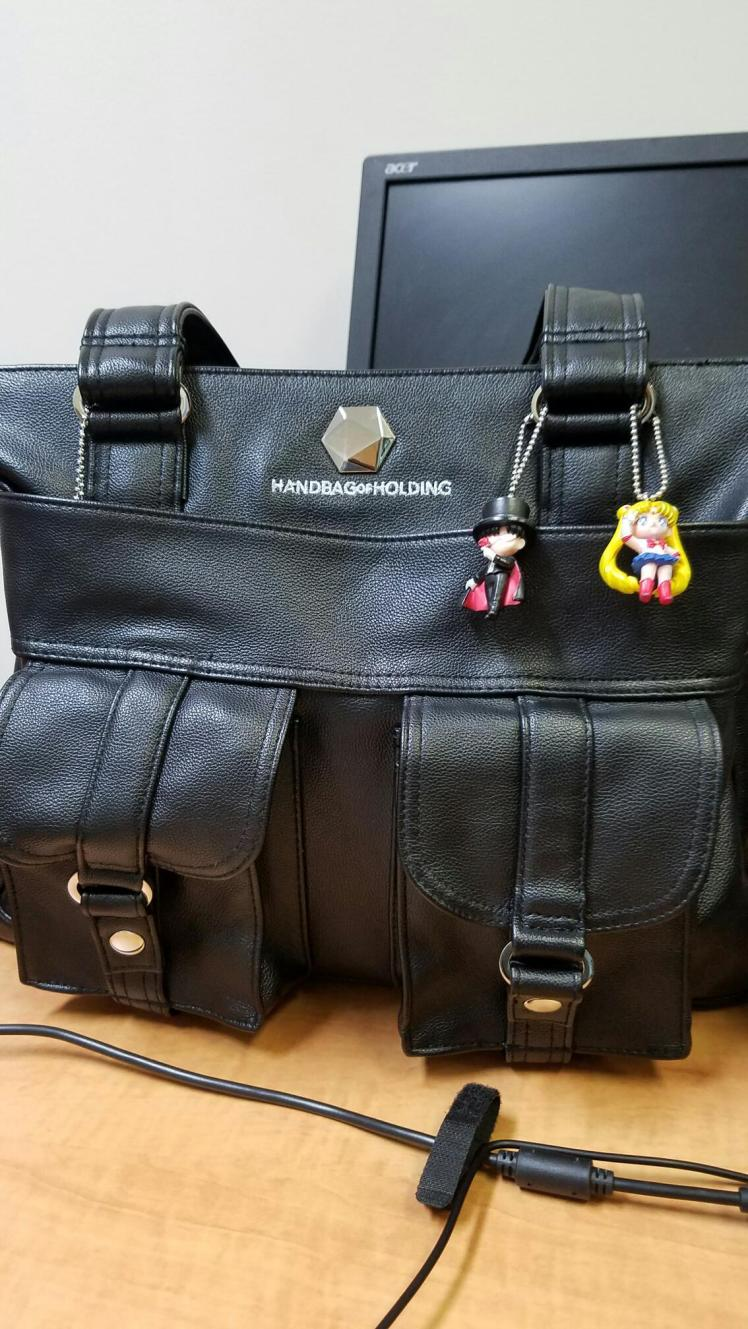 The work bag I can't do without along with my Tuxedo Mask and Sailor Moon adornments.